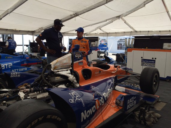 Showing Dominique around an IndyCar.