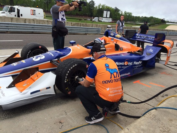 Taking off the Firestone rain tires after IndyCar declares the session dry.
