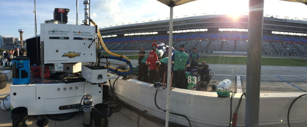 Sun still peeking over the grandstands during evening practice.